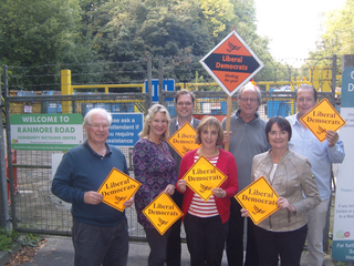 Lib Dem activists campaigning outside one of Surrey's rubbish tips