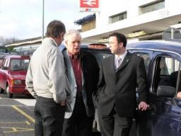 Jonathan Lees & Colin Taylor outside Epsom Station with a Taxi Operator