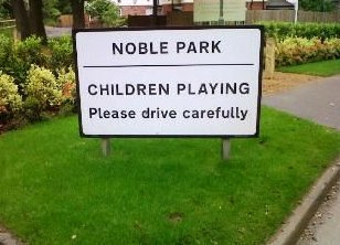 Children Playing sign at Noble Park
