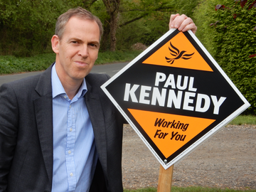 Paul Kennedy with Lib Dem stake board